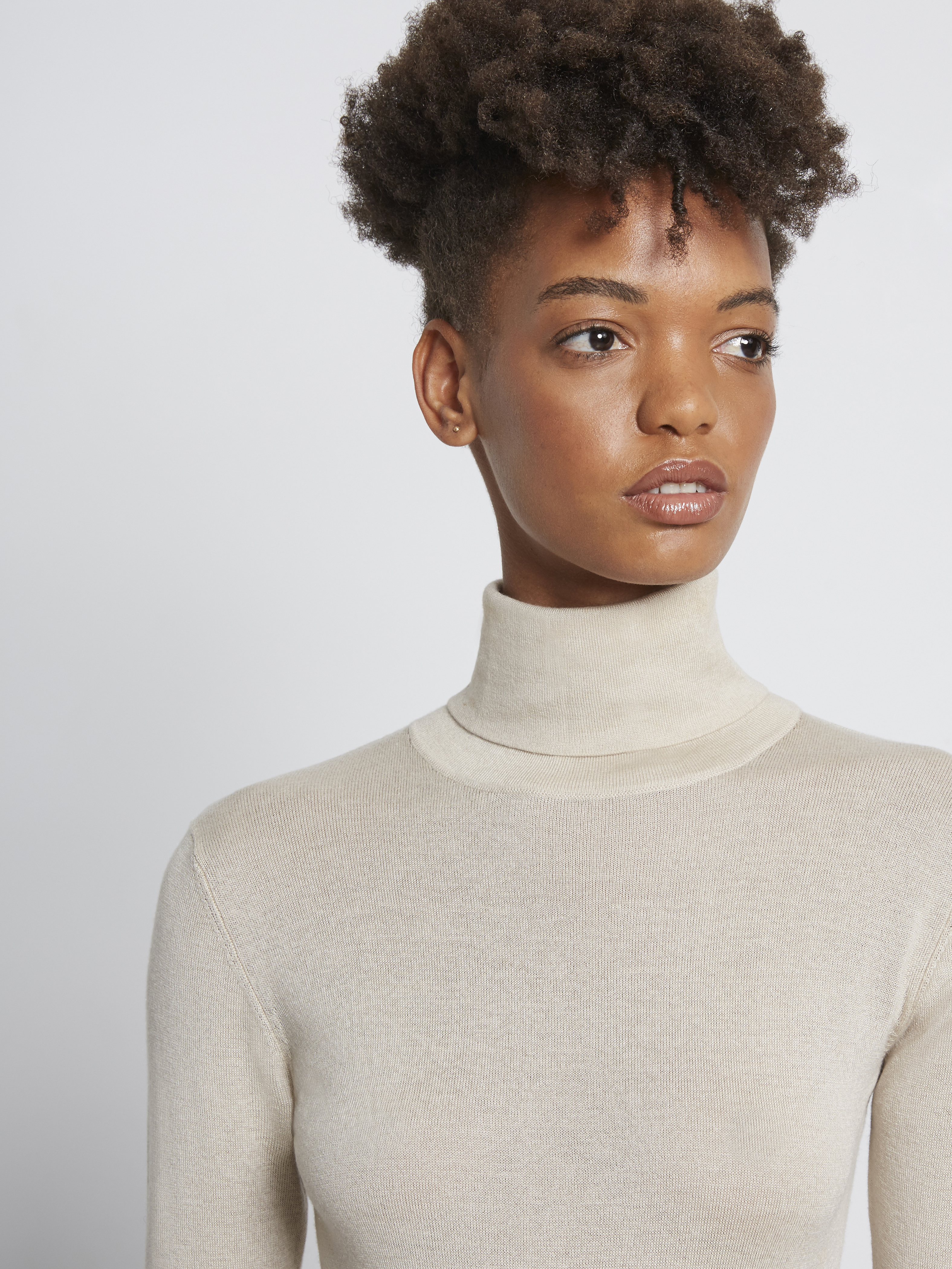 Silk Turtleneck Body with Embroidered Logo This knit body will be your new staple through autumn to winter